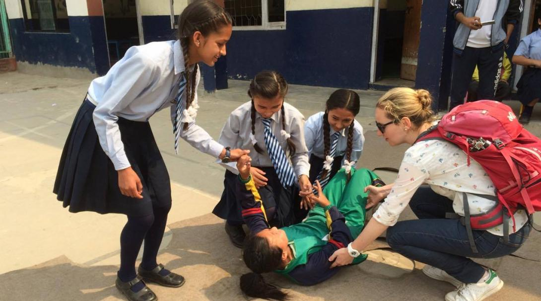 Volunteers at Projects Abroad international medical internships in Nepal teach children first aid.